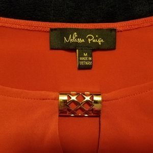 women's orange blouse with gold hardware